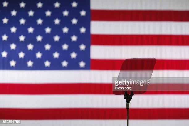 Teleprompter stands in front of an American flag before U.S. President Donald Trump, not pictured, speaks at an event to discuss tax reform at the...