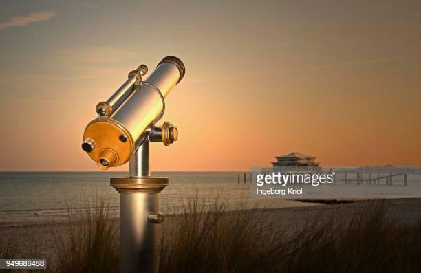 Telescope at Timmendorfer Strand, Teehaus auf Seebruecke at sunrise, Baltic Sea, Schleswig-Holstein, Germany