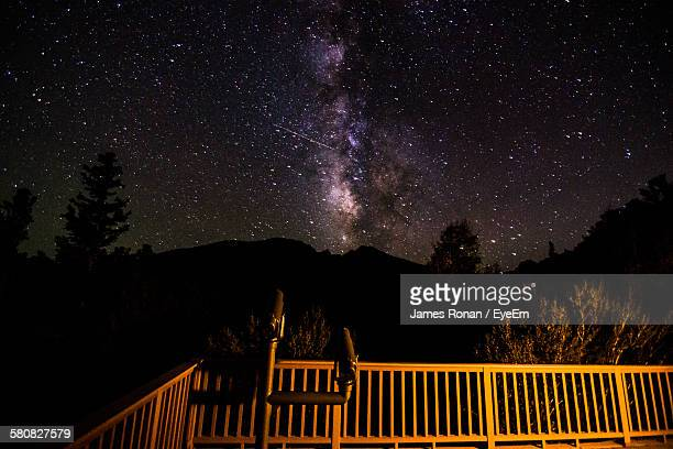 telescope by silhouette mountains against star field - great basin stock pictures, royalty-free photos & images