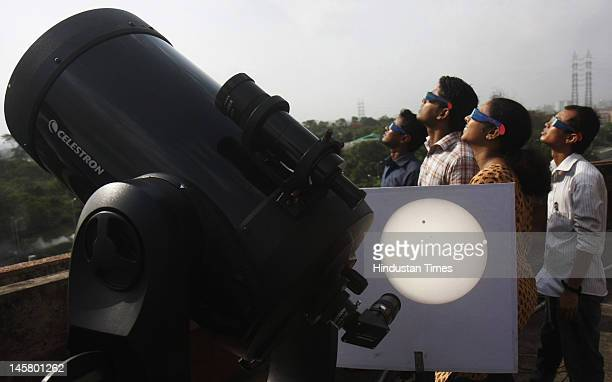 Telescopic view of planet Venus transit across the sun at Science City on June 6 2012 in Kolkata India This is last Venus transit of the century as...