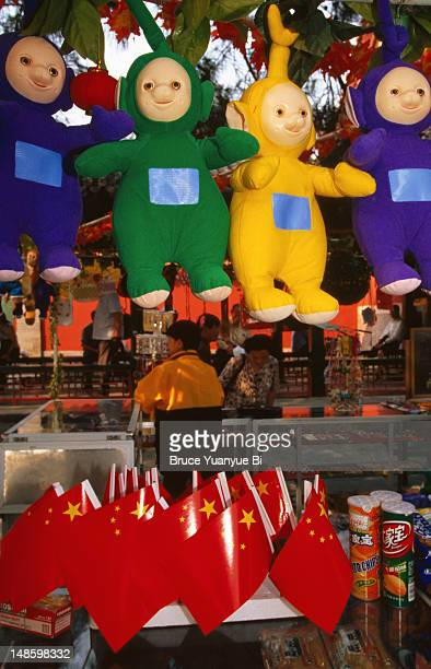 Teletubbies and Chinese flags for sale at souvenir stall, Summer Palace.