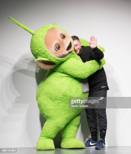Teletubby poses with Bobby Abley as they walk the runway at the Bobby Abley show during the London Fashion Week Men's June 2017 collections on June...