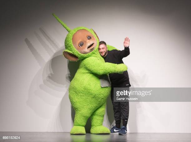 Teletubby poses with Bobby Ashley at the Bobby Abley show during the London Fashion Week Men's June 2017 collections on June 12 2017 in London England