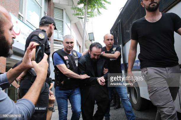Televangelist Adnan Oktar and other suspects are brought to the Haseki Training and Research Hospital May 29 Additional Service Building in order to...