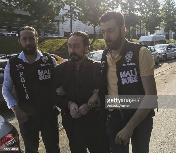 Televangelist Adnan Oktar is detained for alleged membership of a criminal organization after an operation by Turkish police in Istanbul Turkey on...