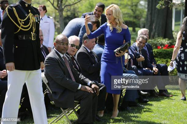Televangelist and chair of U.S. President Donald Trump's evangelical advisory board Paula White takes photographs during an event to mark the...