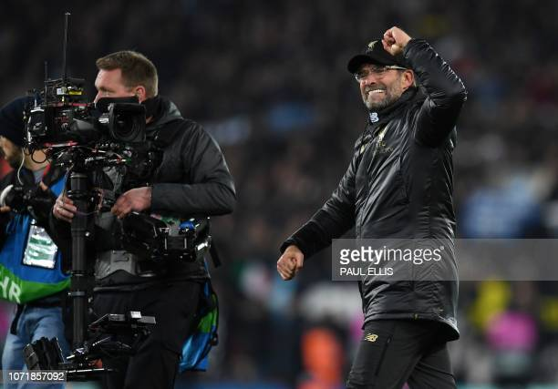 A televeision camera operator films as Liverpool's German manager Jurgen Klopp celebrates after the UEFA Champions League group C football match...