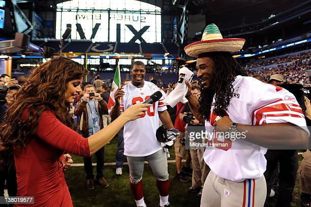 Televisa reporter Marisol Gonzalez interviews Isiah Stanback and Selvish Capers the New York Giants during Media Day ahead of Super Bowl XLVI against...