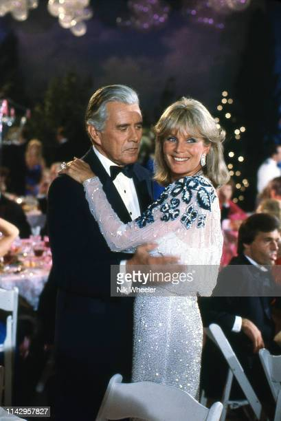 Television actor John Forsythe and costar actress Linda Evans on the set of TV soap Dynasty circa 1984