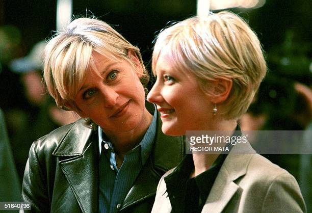 "Television actress Ellen Degeneres arrives with her girlfriend-actress Anne Heche, who has a role in the movie ""Sphere,"" to Mann's Village Theater in..."