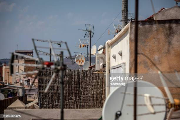 Television aerials and satellite dishes on the roof of a residential apartment in the Barceloneta neighborhood of Barcelona, Spain, on Thursday, July...