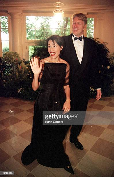 Television anchor Ann Curry of NBC arrives with husband Brian Ross at the White House for an official dinner honoring Indian Prime Minister Atal...
