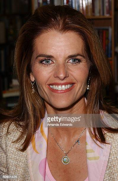 """Television anchorwoman and California First Lady Maria Shriver signs copies of her new children's book """"What's Happening to Grandpa?"""" on May 26, 2004..."""