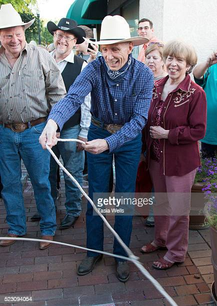 Television and film legend Johnny Crawford ropes around his star during the unveiling ceremony at The Walk of Western Stars on April 21 2016 in...