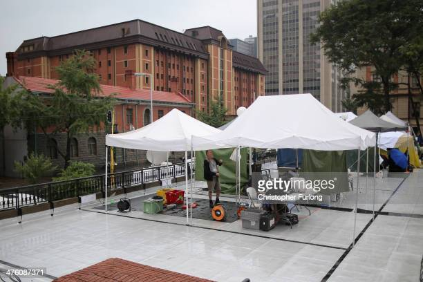 Television and media crews prepare for the start of the Oscar Pistorius trial outside North Gauteng High Court on March 2, 2014 in Pretoria, South...