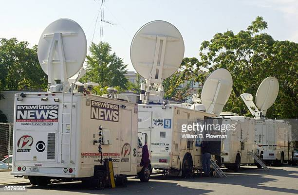 Television and media vans line up October 10 2003 outside of Fenway Park a day prior to game 3 of the American League Championship Series in Boston...