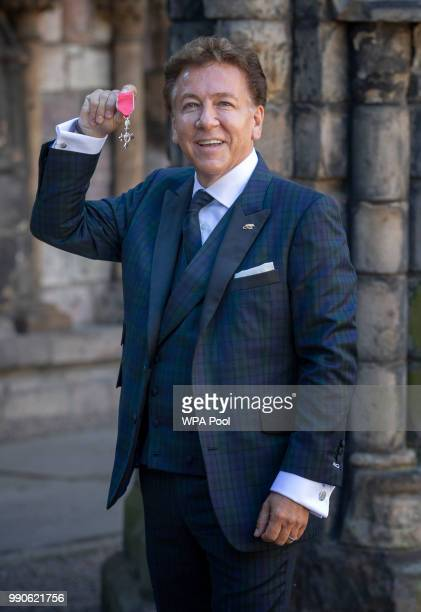 Television and radio presenter Ross King after receiving his MBE for services to drama from Queen Elizabeth II during an Investiture ceremony at the...