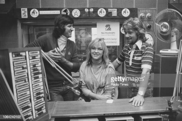Television and radio presenters Ed Stewart Mary Nightingale and Noel Edmonds pictured in a studio October 1978