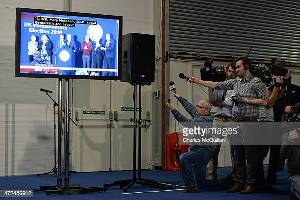 Television and radio reporters record speechs via a closed circuit screen as the General Election count takes place at the King's Hall on May 8, 2015...