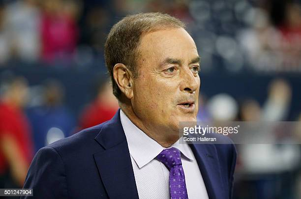 Television announcer Al Michaels watches the Houston Texans warm up before the Texans play the New England Patriots on December 13 2015 at NRG...