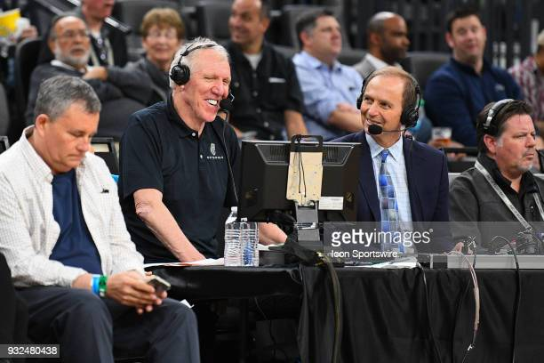 Television announcers Bill Walton and Ted Robinson look during the first round game of the mens Pac12 Tournament between the Washington Huskies and...