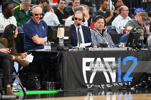 Television announcers Bill Walton and Ted Robinson look on during the quarterfinal game of the mens Pac12 Tournament between the Oregon State Beavers...