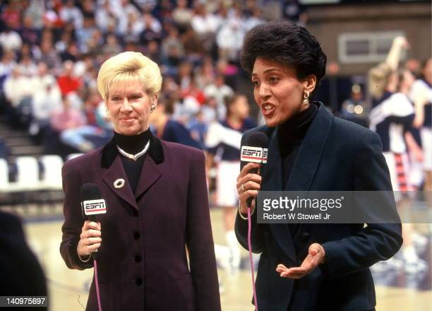 Television basketball commentators Mimi Griffin, left, and Robin Roberts, right, do pre-game analysis prior to a University of Connecticut women's...