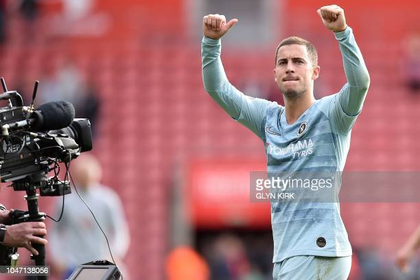 A television broadcast camera films as Chelsea's Belgian midfielder Eden Hazard applauds the fans following the English Premier League football match...