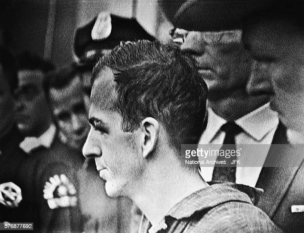 A television broadcast captures Lee Harvey Oswald during a press conference two days after his arrest in conjunction with the assassination of...