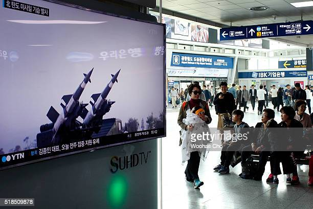 A television broadcast reporting North Korea's surfacetoair missile launch is broadcast at the Seoul Railway Station on April 1 2016 in Seoul South...