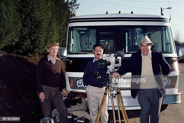Television broadcaster Charles Kuralt far right poses for a photograph with his film crew while traveling in the Pacific Northwest