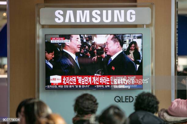 A television broadcasts a photograph of Cho Myounggyon South Korea's unification minister left and Ri Son Gwon chairman of North Koreas Committee for...