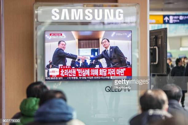 A television broadcasts footage of Ri Son Gwon chairman of North Koreas Committee for the Peaceful Reunification of the Fatherland left and Cho...
