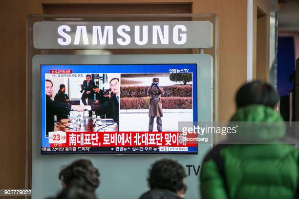 A television broadcasts imagery of Ri Son Gwon chairman of North Koreas Committee for the Peaceful Reunification of the Fatherland left shaking hands...
