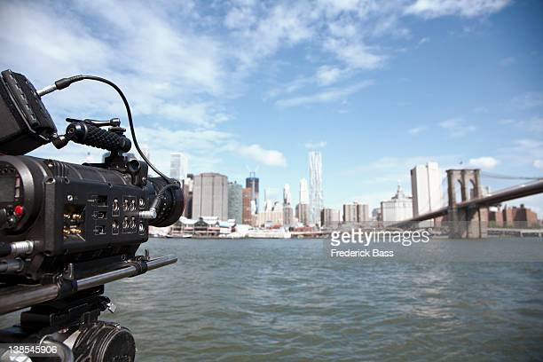 a television camera filming the brooklyn bridge and manhattan skyline - skyscraper film stock pictures, royalty-free photos & images