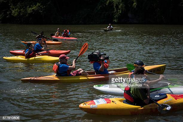A television camera films from a kayak during a Paddling For Patriots event along the Cuyahoga River at Rivergate Park on the second day of the...