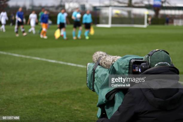 A television camera films the teams walking onto the pitch before the UEFA Youth League group H match between Tottenham Hotspur and FC Porto on March...