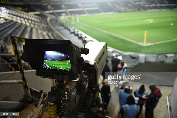 A television camera is positioned to film the English Premier League football match between Hull City and Aston Villa at the KC Stadium in Hull...