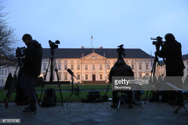 Television camera men stand outside Schloss Bellevue Presidential Palace as Germany's President FrankWalter Steinmeier holds talks in Berlin Germany...