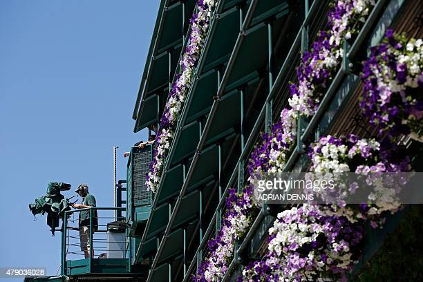 A television camera operator films the action on day two of the 2015 Wimbledon Championships at The All England Tennis Club in Wimbledon southwest...