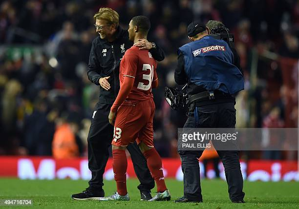 A television camera operator for European payTV broadcaster Sky's Sky Sports channel films Liverpool's German manager Jurgen Klopp reacting with...