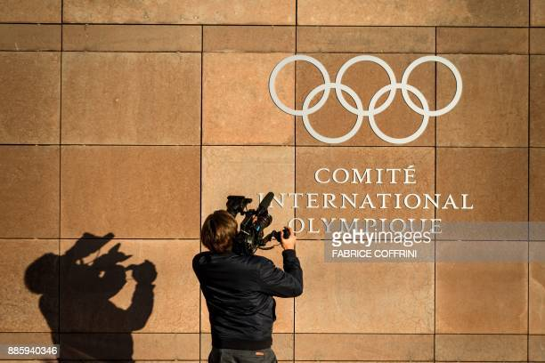 Television cameraman films the logo of the International Olympic Committee at its headquarters in Pully, near Lausanne, prior to an executive meeting...
