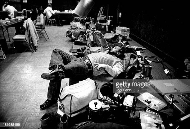 DEC 26 1974 DEC 27 1974 A television cameraman grabs a moment of between photo opportunities