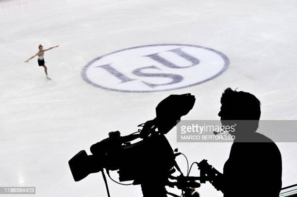 TOPSHOT A television cameraman is silhoueted against the ice rink during the Junior Ladies short program at the ISU Grand Prix of figure skating...