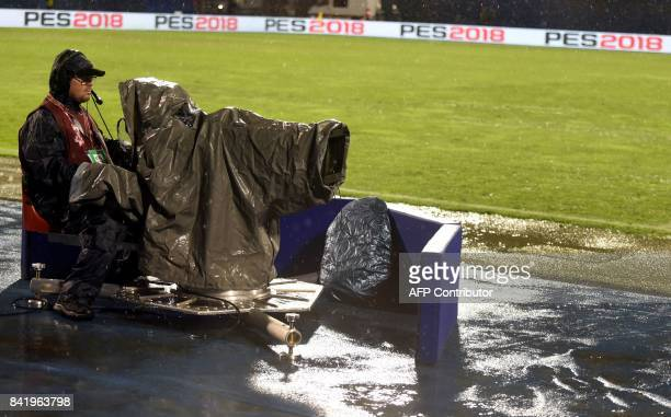 A television cameraman looks on after Croatian and Kosovan players left the field as heavy rain falls during the FIFA World Cup 2018 qualification...