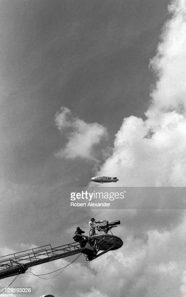CBS television cameraman on a boom and the Goodyear Blimp watch the action during the1984 Daytona 500 on February 19 1984 at the Daytona...
