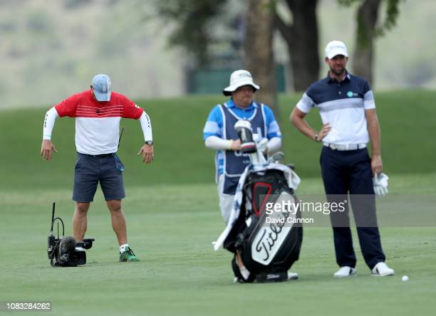 A television cameraman tries to get some cool air as Scott Jamieson of Scotland prepares to play his second shot on the par 5 second hole during the...