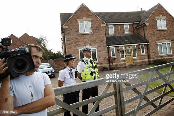 A television cameraman waits outside the McCann's family home in Rothley Leicestershire 09 September 2007 before the family arrived home from...