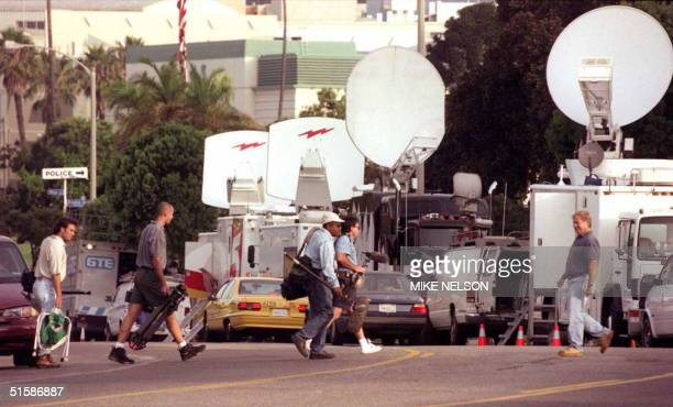 Television cameraman walk in front of satellite trucks on Main Street in Santa Monica outside the courthouse where evidence proceedings in the OJ...