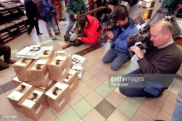 """Television cameramen shoot footage of cases of the new Monica Lewinsky book entitled 'Monica's Story"""" at a Washington, DC Barnes and Noble bookstore..."""